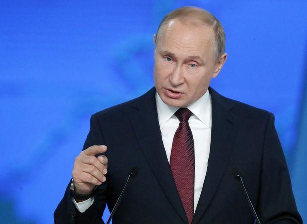 Putin esiintyi itsevarmasti, niin kuin hänellä on tapana.