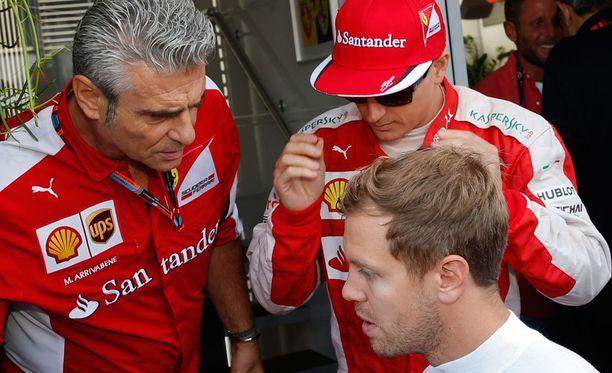 Ferrarin voimakolmikko: Maurizio Arrivabene, Kimi Räikkönen ja Sebastian Vettel.
