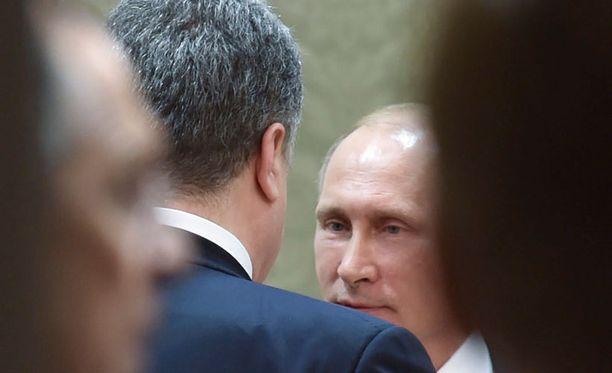 Poroshenko ja Putin keskustelivat neuvotteluissa.