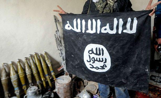Tanskan kansalainen on lähtöisin Libanonista ja Ruotsin kansalainen Irakista. Arkistokuva Isisin lipusta.