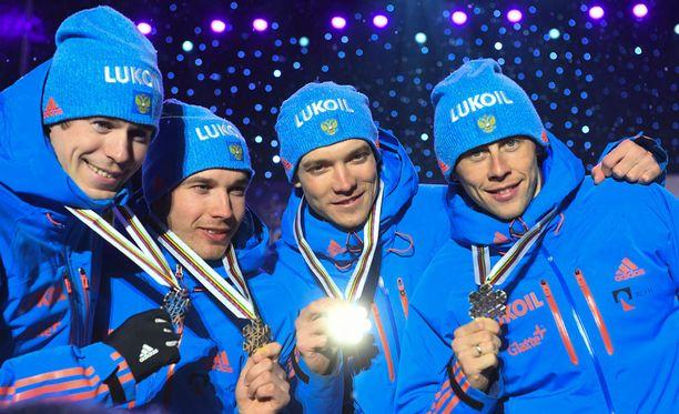 Venäjän hopeaa voittaneessa viestijoukkueessa hiihtivät Lahdessa Sergei Ustjugov, Aleksei Chervotkin, Aleksander Bessmertnykh ja Andrei Larkov.