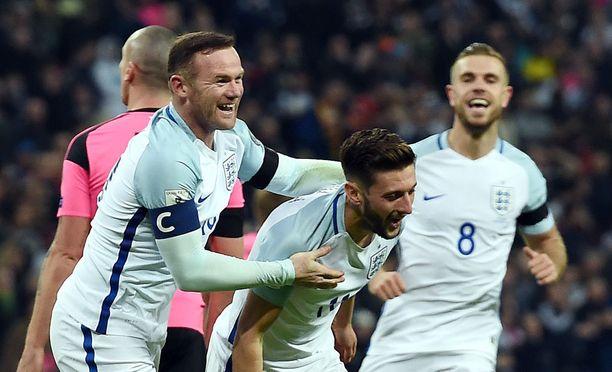 Wayne Rooney (vas.) ja kumppanit juhlivat skottien kustannuksella.