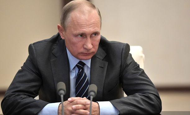 Presidentti Vladimir Putin hoputtaa myös Yhdysvaltoja hävittämään kemialliset aseensa.