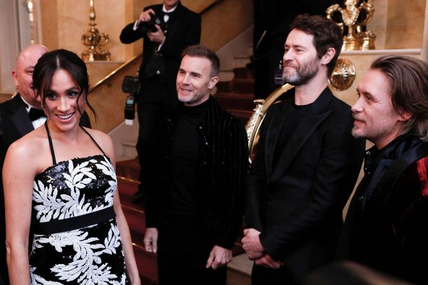Meghan tapasi Take Thatin Gary Barlow'n, Howard Donaldin ja Mark Owenin.