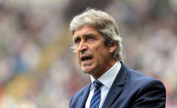 West Ham -manageri Manuel Pellegrini joutui vaimonsa kanssa aseellisen ryöstön uhriksi.