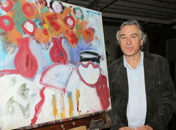 Robert De Niro ja yksi hänen isänsä maalauksista.