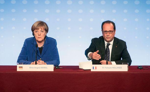 Angela Merkel ja Francois Hollande pitävät yhteisen puheen.