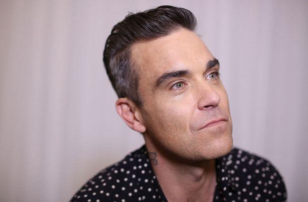 Yksi konsertin esiintyjistä on Robbie Williams.