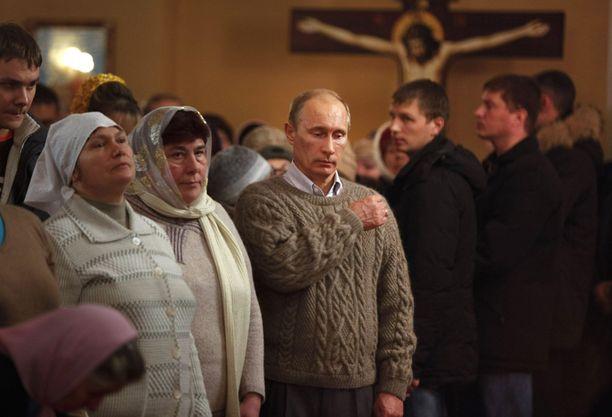 Venäjän pääministeri Vladimir Putin osallistui ortodoksiseen joulumessuun Turginovon kylässä.