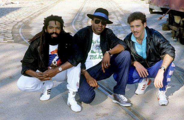 Bad Boys Blue vuonna 1986 Munchenissä. Vasemmalta Trevor Oliver Taylor, Andrew Freddie Thomas ja  John Edward McInerney.