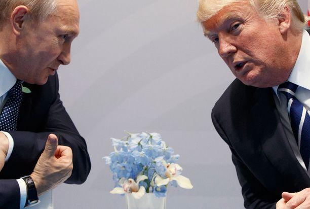 Vladimir Putin ja Donald Trump Hampurissa viime kesänä.
