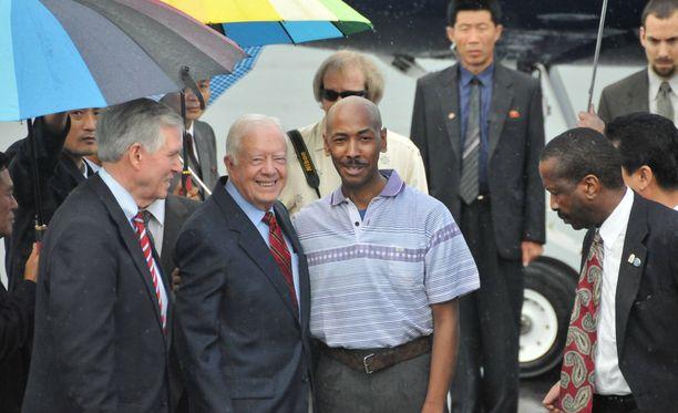 Yhdysvaltain ex-presidentti oli mukana neuvotteluissa, jotka johtivat Aijalon Mahli Gomesin vapauttamiseen. Gomes kuvassa Jimmy Carterin oikealla puolella vuonna 2010.