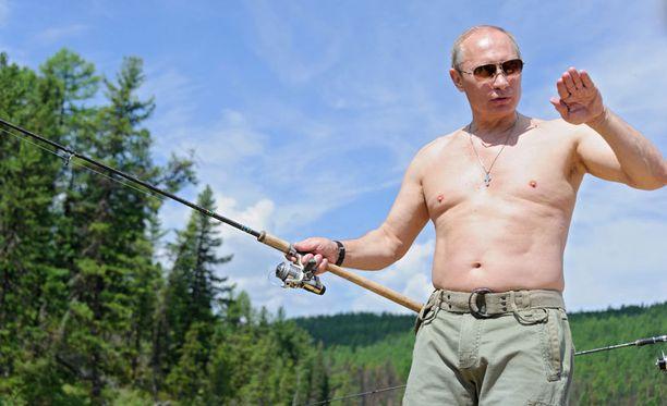 Kalastus miellyttää presidenttiä.