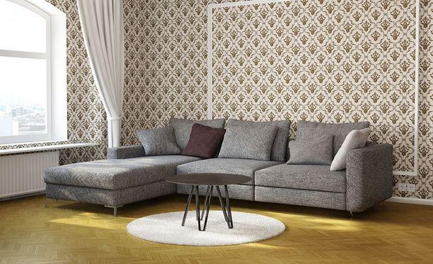 Isossa olohuoneessa sohvan ei tarvitse olla kiinni seinässä.