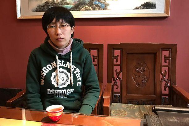 Jia JInglongin sisko Jia Jingyuan puhui tapauksesta toimittajille Beigaoyingin kylässä Hebeissä lokakuun lopussa.