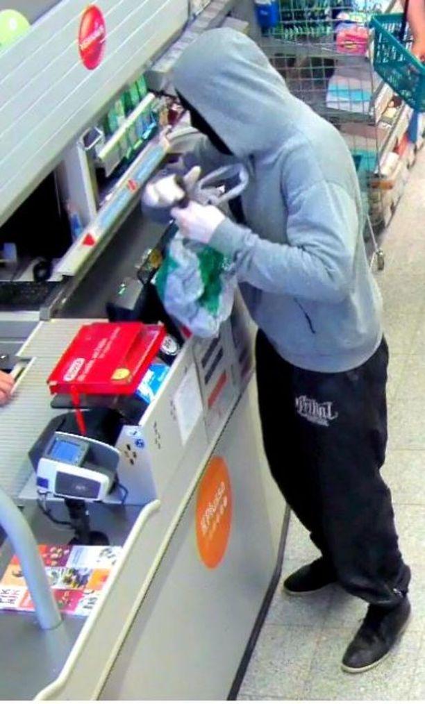 Tummaan vaatteeseen kasvonsa verhonnut mies vei veitsellä uhaten rahaa kaupasta.