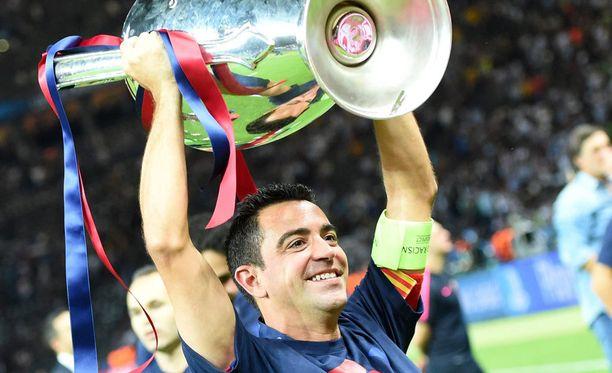 Xavi nosti viimeisen kerran kannua Barcelona-paidassa.