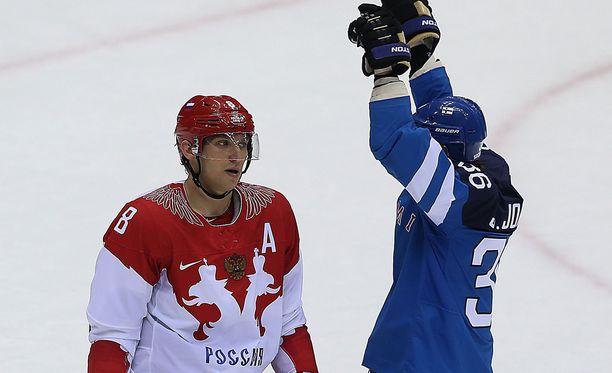 Alexander Ovetshkin myrtyi Sotshissa 2014, kun Jussi Jokinen juhli Suomen voittoa.