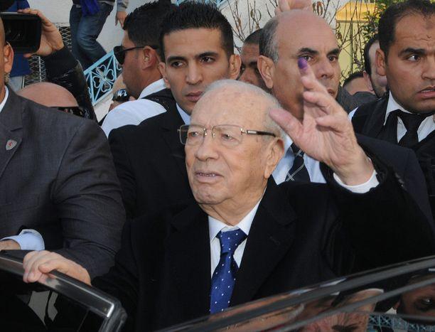 SEURAAVA PRESIDENTTI?Beji Caid Essebsistä tulee ensimmäinen vapailla vaaleilla valittu Tunisian presidentti, jos ovensuukyselyt pitävät paikkansa.