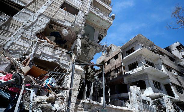 Douma on pommitettu rauniokaupungiksi vuosia jatkuneissa taisteluissa.