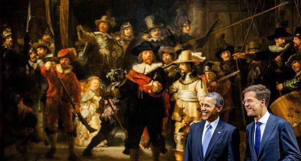 Barack Obama yhdessä Hollannin ex-pääministerin Mark Rutten kanssa taustalla Rembrandtin Yövartio.