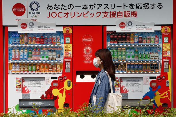 Tokion kisat siirtyivät vuodella koronaviruksen takia. Kasvomaskit olivat tuttu näky Japanissa.