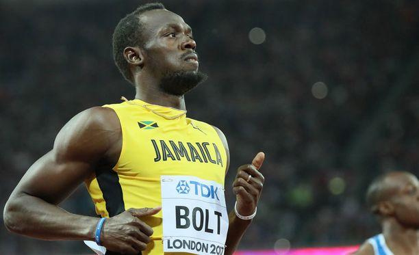 Usain Bolt ei ollut täysin tyytyväinen alkueräjuoksuunsa - tai Lontoon olympiastadionin lähtötelineisiin.