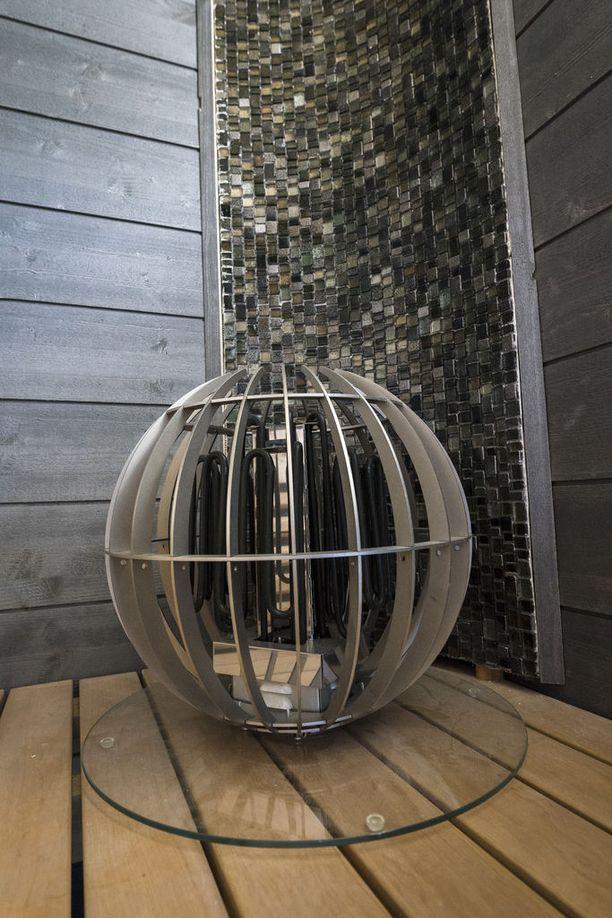 Saunan kiuas voi saada myös pyöreän muodon. Asuntomessukohde 29.