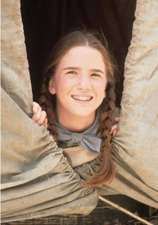 Tällaisena me hänet muistamme: iloisena uudisraivaahaperheen tyttärenä.
