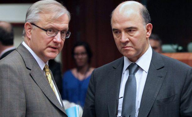 Olli Rehnin ja Ranskan talousministerin Pierre Moscovicin ilmeet olivat paljonpuhuvat Euroryhmän kokouksen vihdoin alettua.