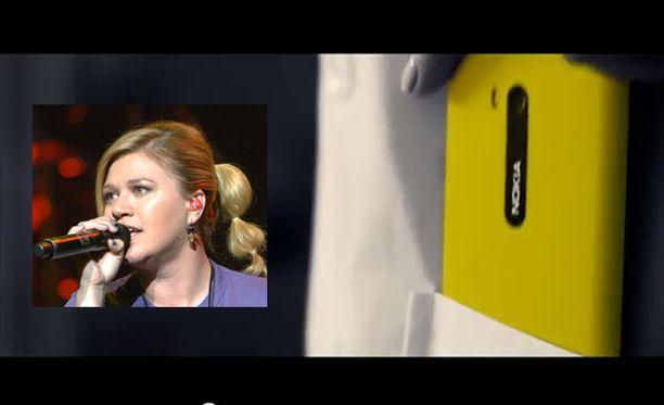 Keltainen puhelin ja musiikkivideolla esiintyvä tyttö ovat muuten mustavalkoisen kohtauksen ainoat väripilkut.