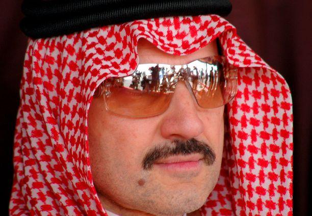 Saudiprinssi Al-Waleed bin Talal kiistää luopuneensa omaisuudestaan.