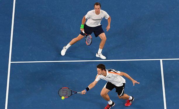 Henri Kontinen (ylh.) ja John Peers ovat nyt Grand Slam -voittajia.