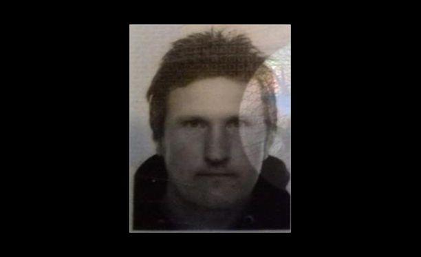 Oheisessa asiakirjankuvassa kadonnut mies esiintyy ilman partaa.