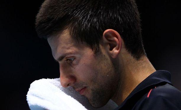 Novak Djokovic kärsi yllätystappion David Ferrerille.