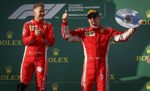 Sebastian Vettel (vas.) on juhlinut GP-podiumilla jo sata kertaa. Kimi Räikköselle Australian GP oli 92. kerta.