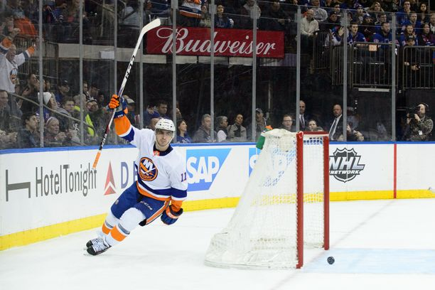 January 12, 2018: New York Islanders left wing Shane Prince (11) scores his first goal of the season in the first period against New York Rangers goaltender Ondrej Pavelec (31) during the game between The New York Rangers and The New York Islanders at Madison Square Garden in Manhattan, New York. Mandatory credit: Kostas Lymperopoulos/CSM (Credit Image: © Kostas Lymperopoulos/CSM via ZUMA Wire)