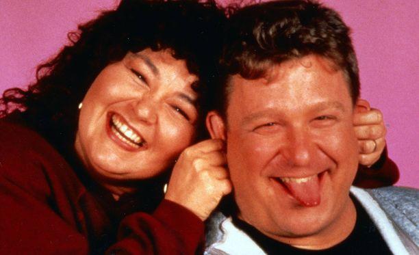 Roseanne Barr ja John Goodman hassutelevat vuonna 1988.