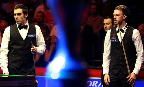 O'Sullivan (vas.) ja Trump kohtasivat Britannian mestaruusturnauksessa 2014. Tuolloin O'Sullivan voitti 10-9.