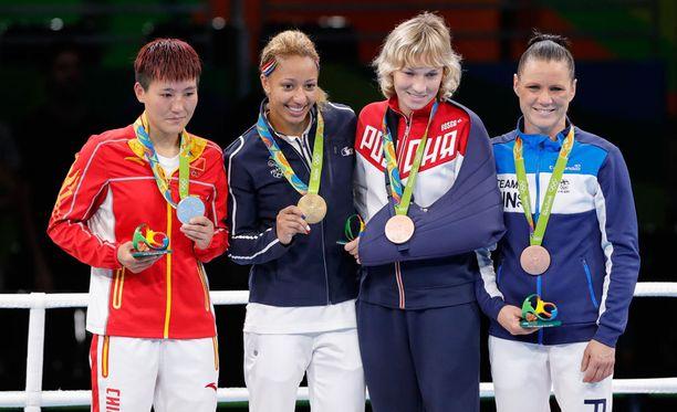 Junhua Yin, Estelle Mossely, Anastasiia Beliakova ja Mira Potkonen ovat 60-kiloisten sarjan olympiamitalistit.