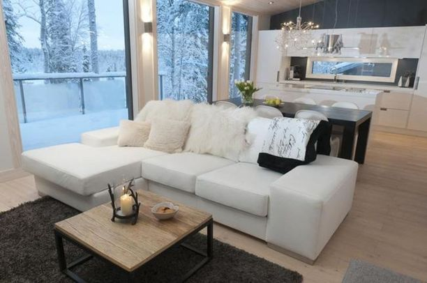 Rinnetontilla Rukariutan alueella sijaitseva moderni paritalohuoneisto on valmistunut vuonna 2011.