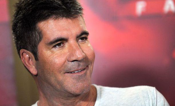Simon Cowell ei ole ystävän mukaan halunnut korostaa lapsirakasta puolta itsessään.