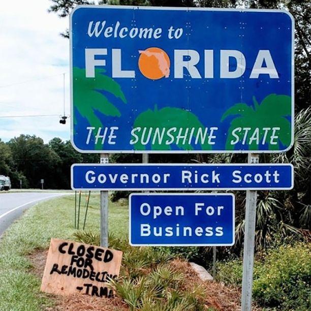 """Tervetuloa auringonpaisteen osavaltioon, julistaa kyltti. """"Irma"""" on käynyt lisäämässä siihen, että Florida on suljettu """"uudelleen suunnittelun"""" vuoksi."""