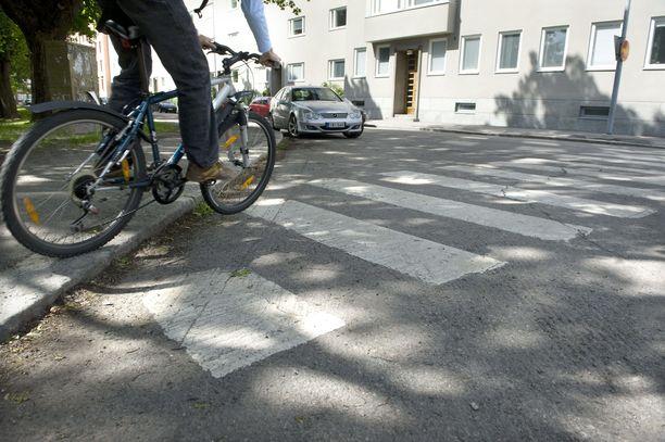 Kuvituskuva polkupyöräilijästä.