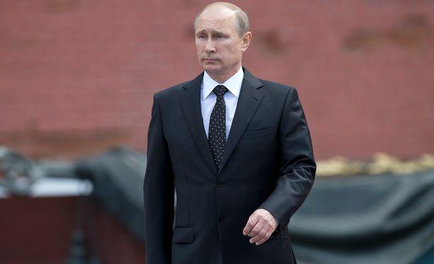 Putinin mukaan Venäjä suojelee edelleen tarvittaessa Ukrainan venäjänkielistä vähemmistöä.