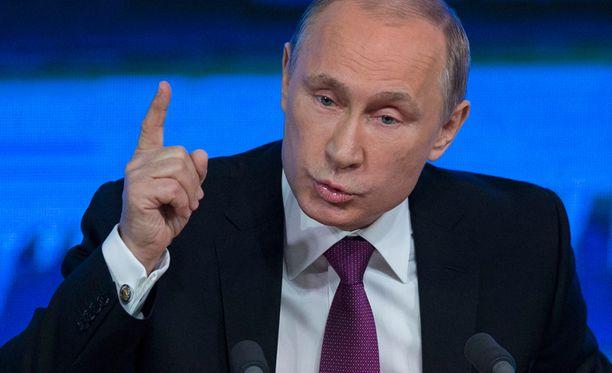 Kriisiin tarvitaan Putinin mukaan poliittinen ratkaisu, ei pakkokeinoja.