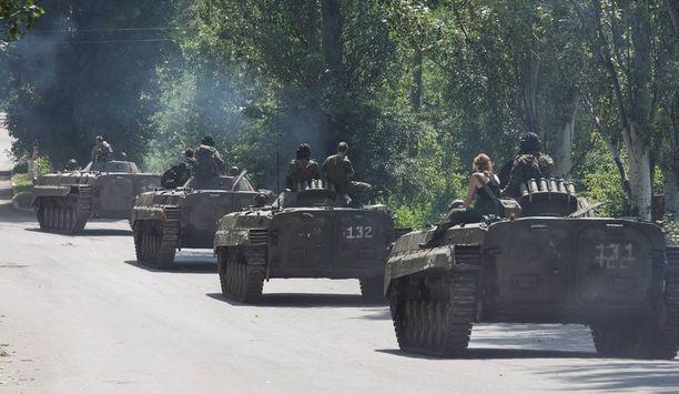 Naton kenraalin mukaan Venäjä on valloittanut Krimin ja Donbassin alueen Ukrainassa. Kuvassa separatistikapinallisten joukkoja.