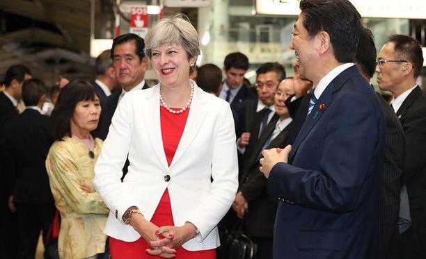 Japanissa vierailulla oleva Britannian pääministeri Theresa May sanoo johdattavansa konservatiivipuolueensa seuraaviin vaaleihin, jotka on määrä järjestää vuonna 2022.