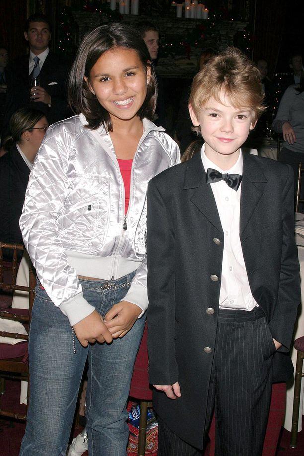 Lapsinäyttelijät Thomas Brodie-Sangster ja Oliviaa näytellyt Olivia Olson vuonna 2003.