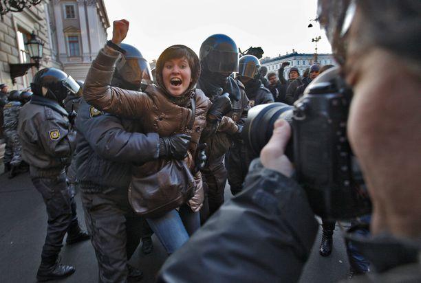 Opposition mielenosoitus presidentinvaalien jälkeen, kun Vladimir Putin oli valittu presidentiksi.